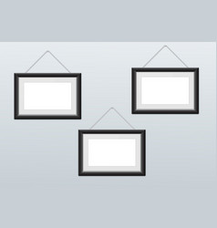White picture frames hanging on the wall vector