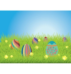 Colored eggs on a grass field vector