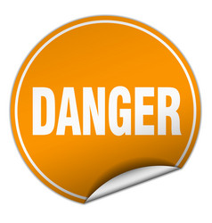 Danger round orange sticker isolated on white vector