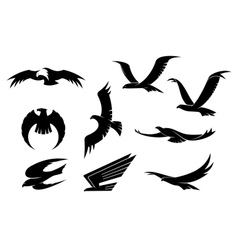 Silhouette set of flying birds vector image