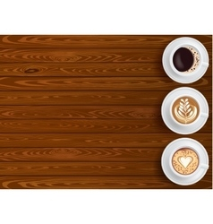 Wooden background and coffee cups composition vector