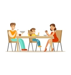 Mom dad and son having breakfast happy family vector