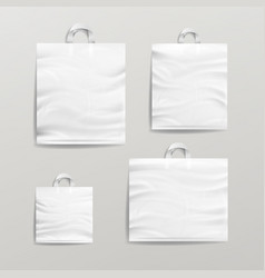 Plastic shopping bags set white empty mock vector