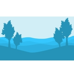 Silhouette of tree on blue backgrounds landscape vector