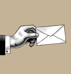 Hand with a postal envelope vector