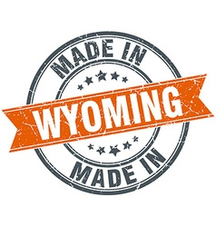 Wyoming orange grunge ribbon stamp on white vector