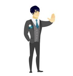 Asian groom showing stop hand gesture vector