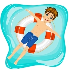Boy floating on an inflatable circle in the pool vector image