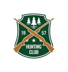 Hunting insignia with crossed rifles on a shield vector