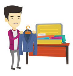 Young man packing his suitcase vector