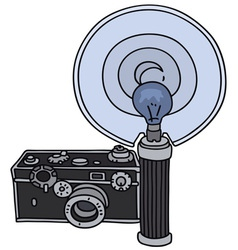 Old camera with flashlight vector