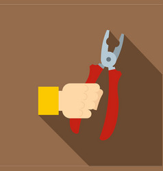 Hand holding pliers with red handles icon vector