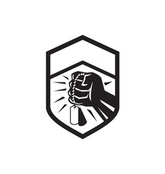 Clenched fist holding dogtag crest retro vector