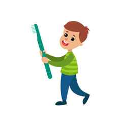 happy little boy carrying giant toothbrush vector image