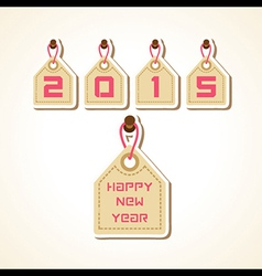creative New Year 2015 design with hanging label vector image