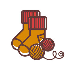 knitted warm socks and balls of woolen threads vector image