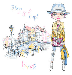 Fashion girl in winter clothes in bruges vector