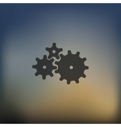 cogwheel icon on blurred background vector image