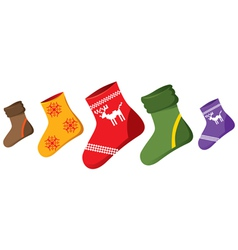 Christmas socks of differen colors vector
