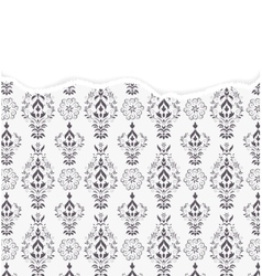 Damask pattern with torn paper vector