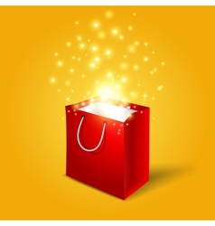 Red shopping bag with magic light fireworks from vector