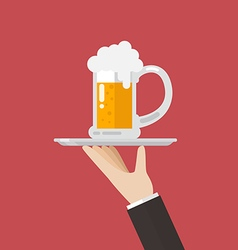 Waiter serving a glass of beer vector image