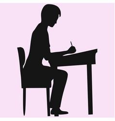 Schoolboy sitting at a school desk vector