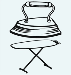 Old iron and ironing board vector image