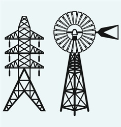Old windmill and electric pole vector