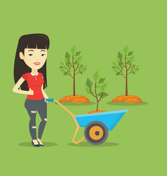 woman pushing wheelbarrow with plant vector image