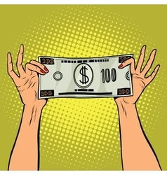 Female hands holding a hundred dollar bill vector