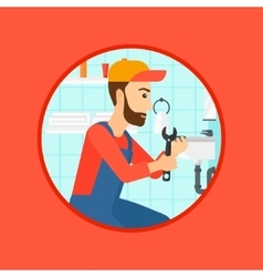 Plumber fixing sink pipe with wrench vector