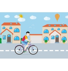 Man riding his bike on the road among buildings vector
