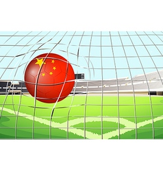 A soccer ball at the field with the flag of china vector
