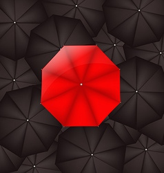 Red Umbrella Against Black Umbrellas vector image