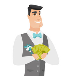 Young caucasian groom holding money vector
