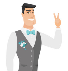 Young caucasiangroom showing the victory gesture vector