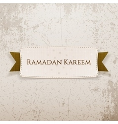 Ramadan kareem paper tag with text and ribbon vector