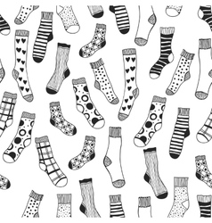 Seamless black and white pattern of doddle socks vector