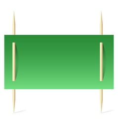Green paper on toothpicks vector image