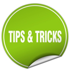 tips tricks round green sticker isolated on white vector image
