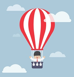 Businessman in hot air balloon vector