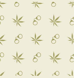 Seamless pattern with cannabis leaves and handcuff vector