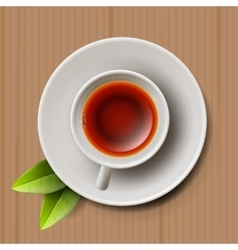 Cup of black tea top view on cardboard vector