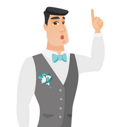 Young groom with open mouth pointing finger up vector