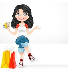Beautiful brunette girl with a credit cards in his vector image