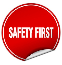 Safety first round red sticker isolated on white vector