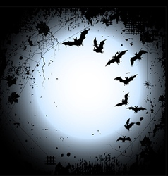 Halloween background with a full moon and bats vector