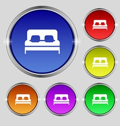 Sofa icon sign round symbol on bright colourful vector