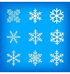 white snowflakes on blue background vector image vector image